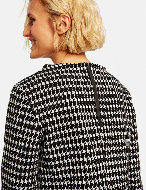 Dress with a houndstooth pattern