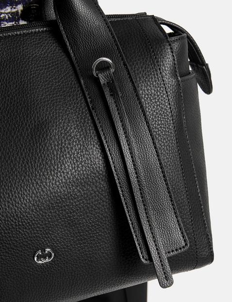 Handbag with eyelet details