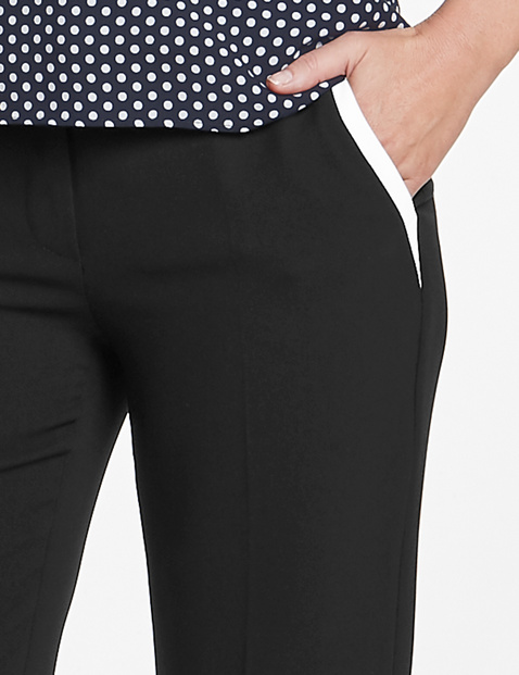 Trousers with contrasting piping