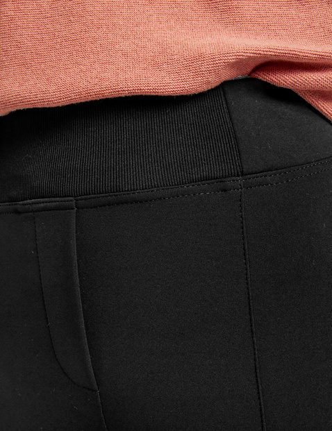 Trousers with an elasticated waistband