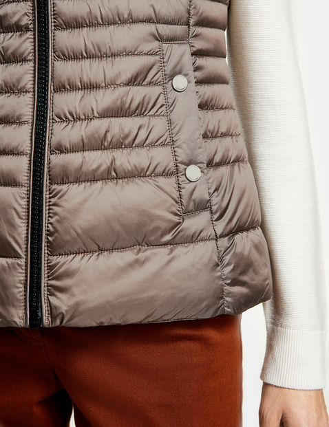 Quilted body warmer with a downy feel