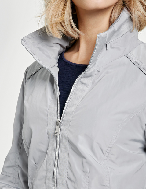 Jacket with piped details