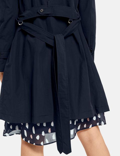 Short coat with a cinch belt