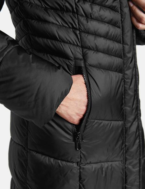 Gewatteerde mantel met capuchon