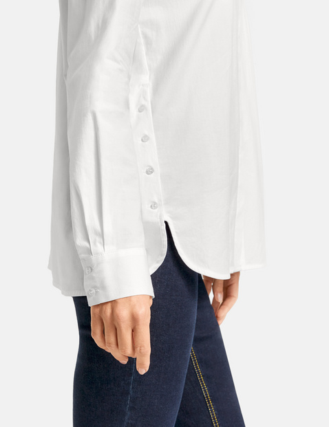 Long sleeve blouse with a concealed button placket