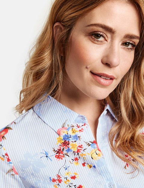 Blouse with 3/4-length sleeves and scattered flowers