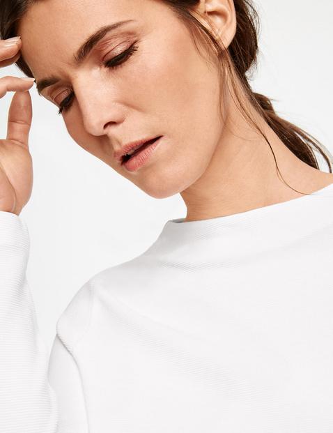 3/4-sleeve top with an asymmetric hem