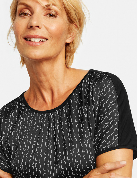 Top with a graphic pattern
