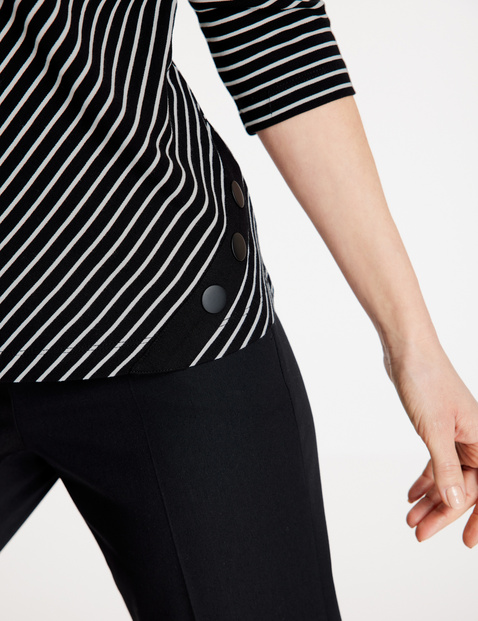 3/4 sleeve top with a diagonal stripe