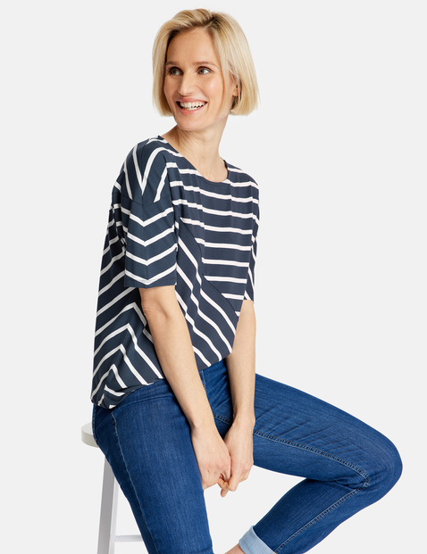 3/4-length sleeve top with a mix of stripes